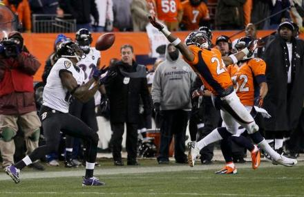 Baltimore Ravens wide receiver Jones catches a pass behind Denver Broncos free safety Moore and then scores a touchdown late in the fourth quarter in their NFL AFC Divisional playoff football game in Denver